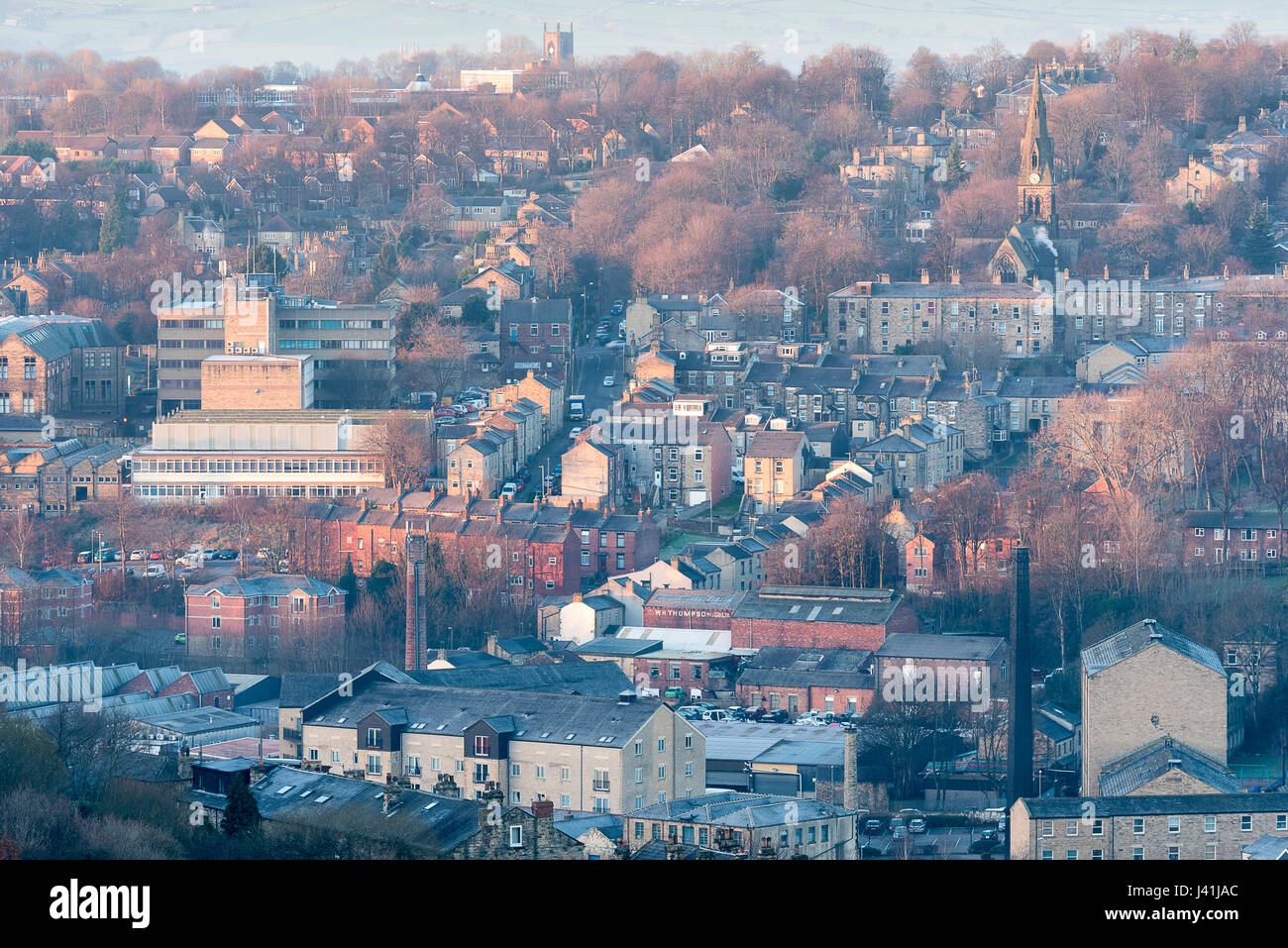 Elevated view of Dewsbury in the morning with church and mill chimneys - Stock Image