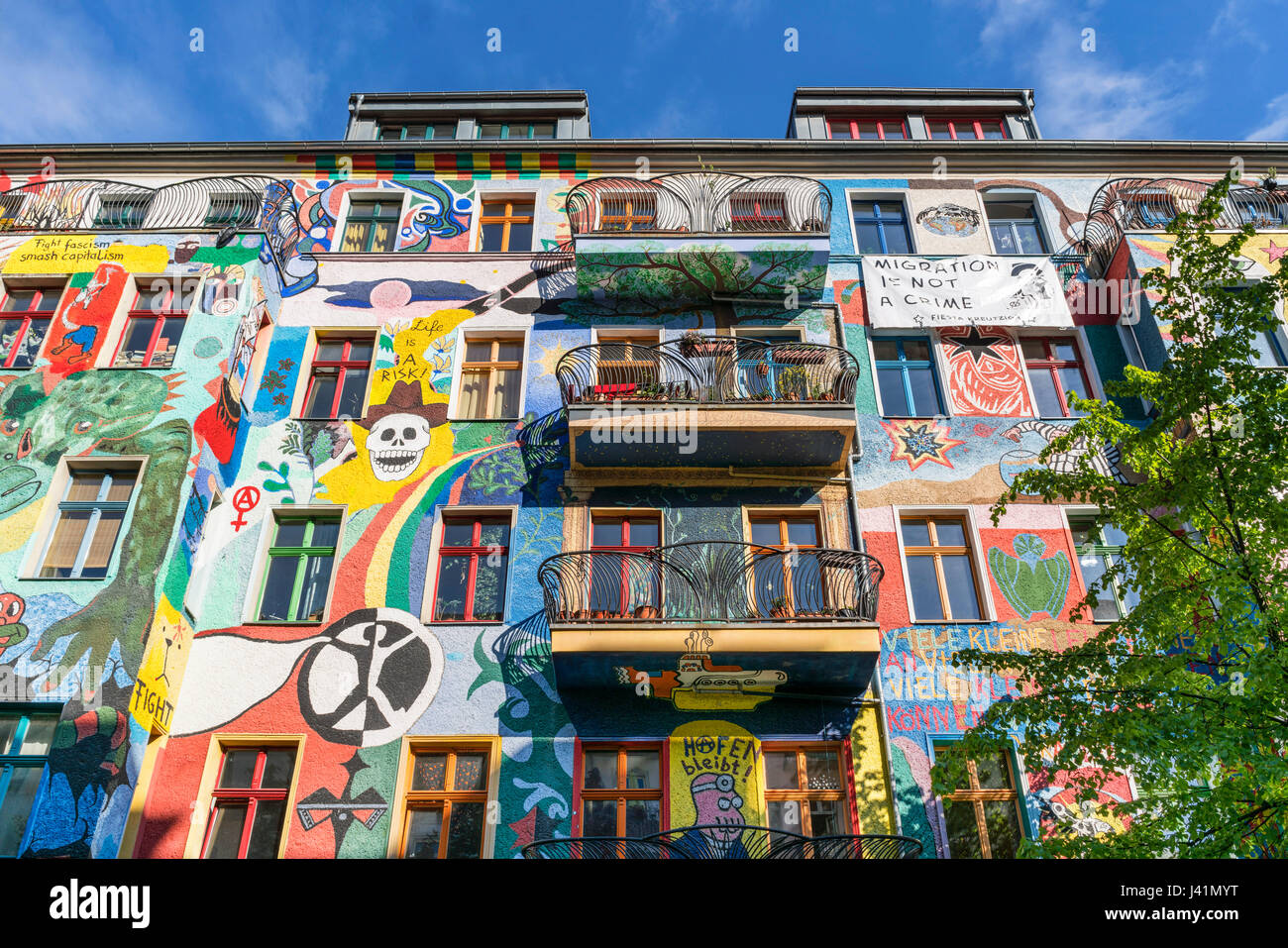 Painted facade in Friedrichshain, colorful wall painting,  Berlin, Germany Stock Photo