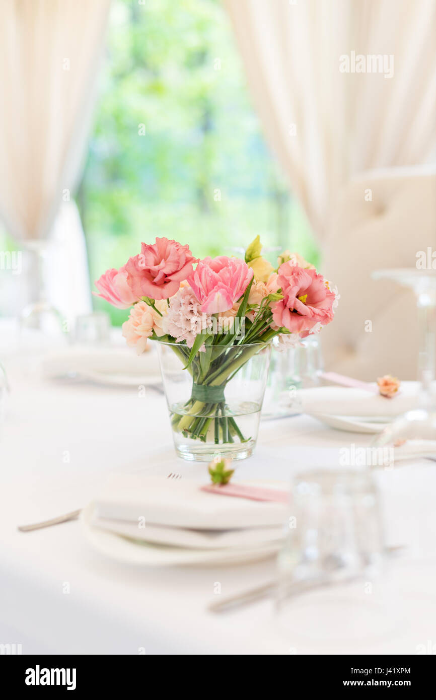 Flower table decorations for holidays and wedding dinner. Table set ...