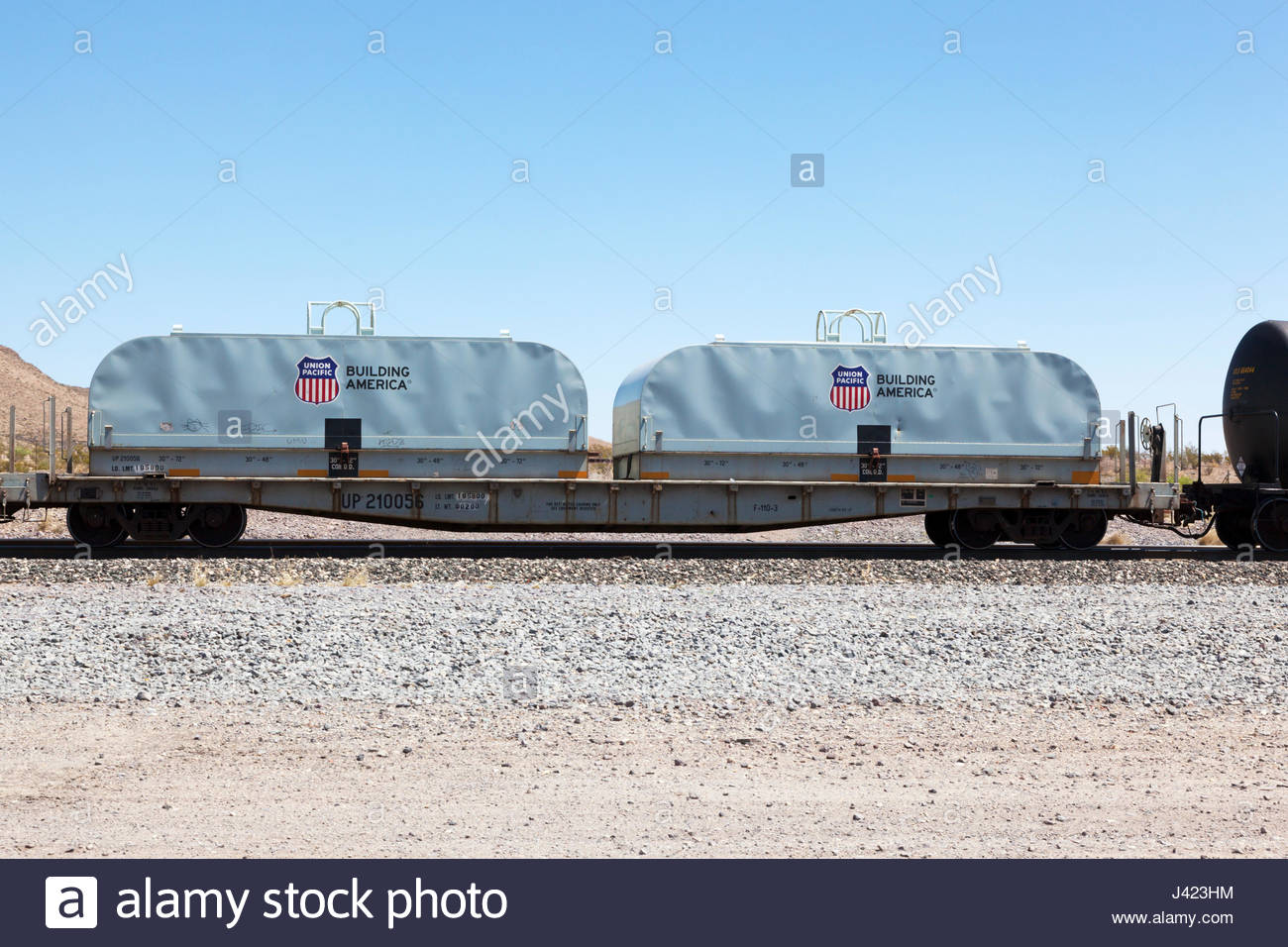 Trough coil car on Union Pacific Railroad in southwestern New Mexico - Stock Image