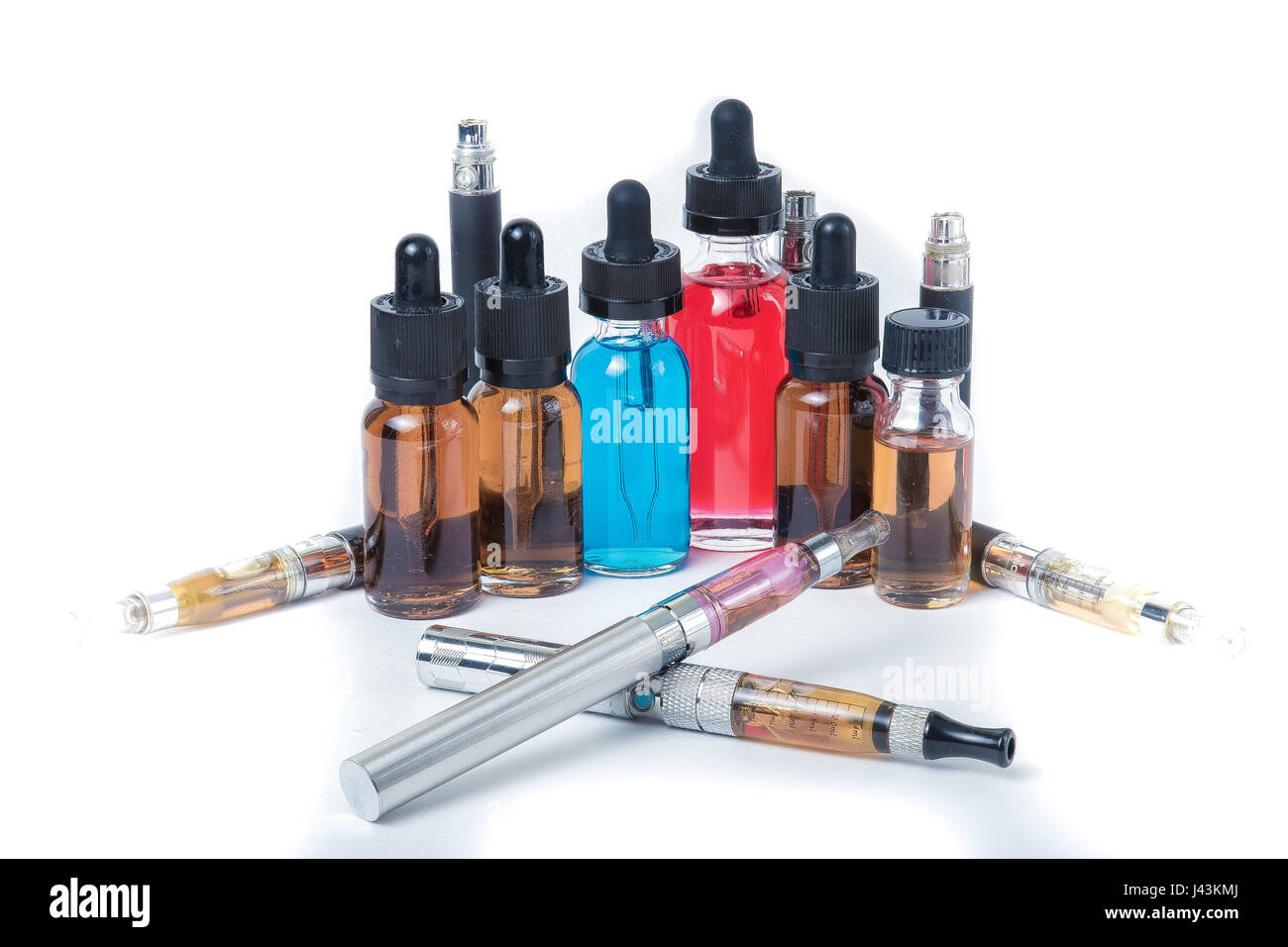 Thin e-cigarettes with glass bottles on white background - Stock Image