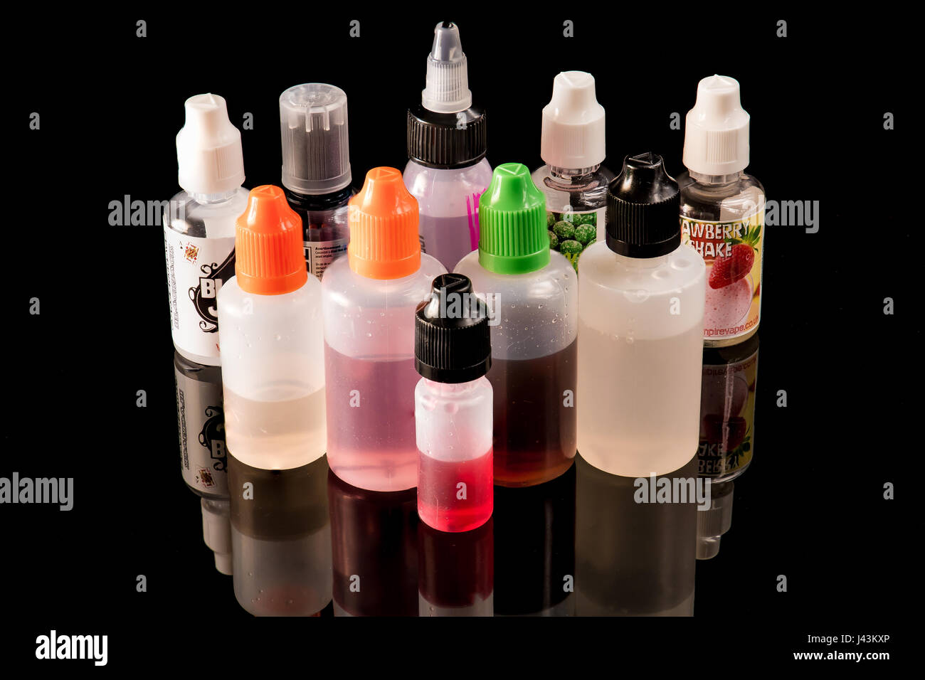 All plastic e-liquid bottles together - Stock Image