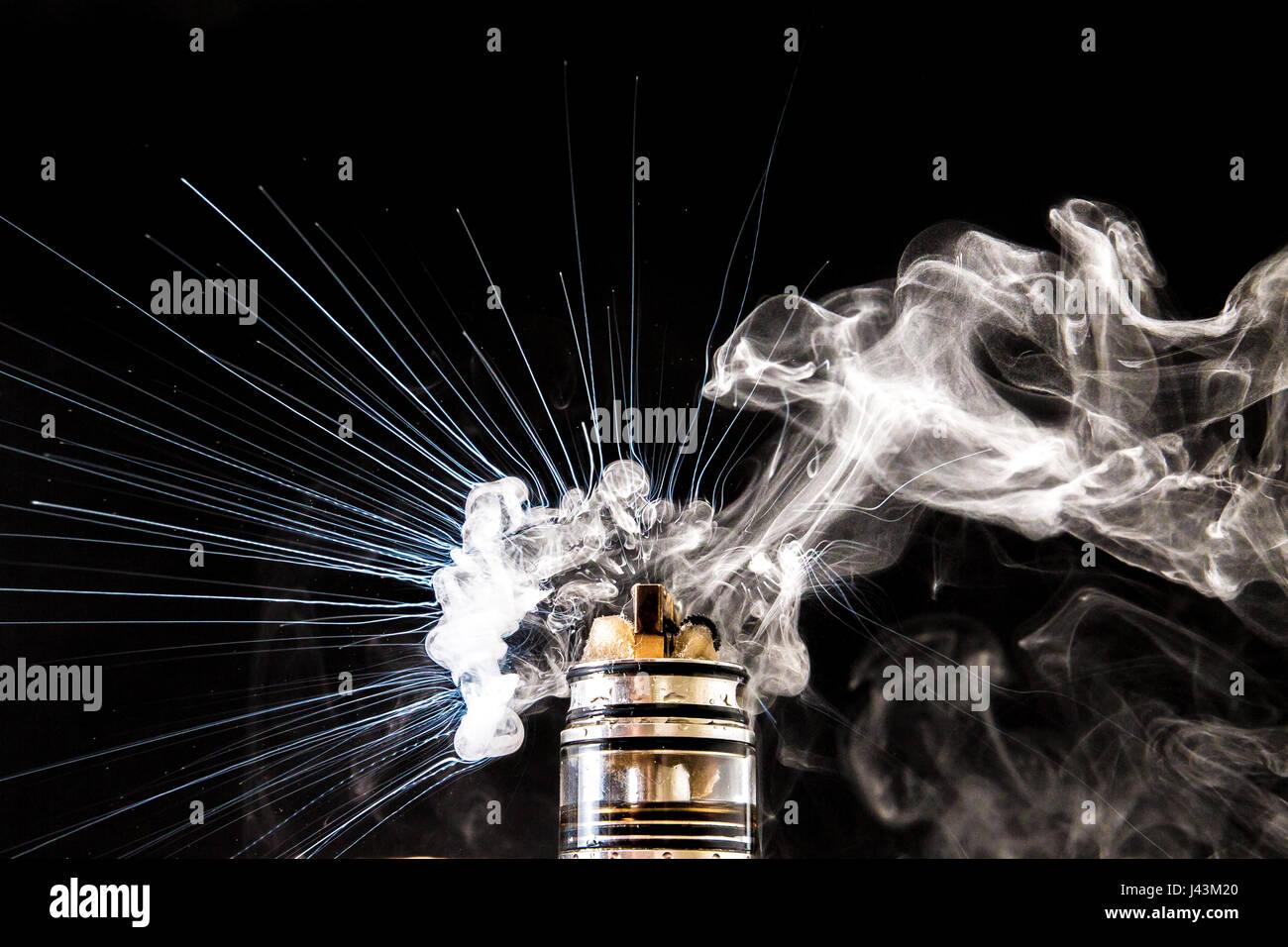 Dissassembled electronic Cigarette vape explosion - Stock Image