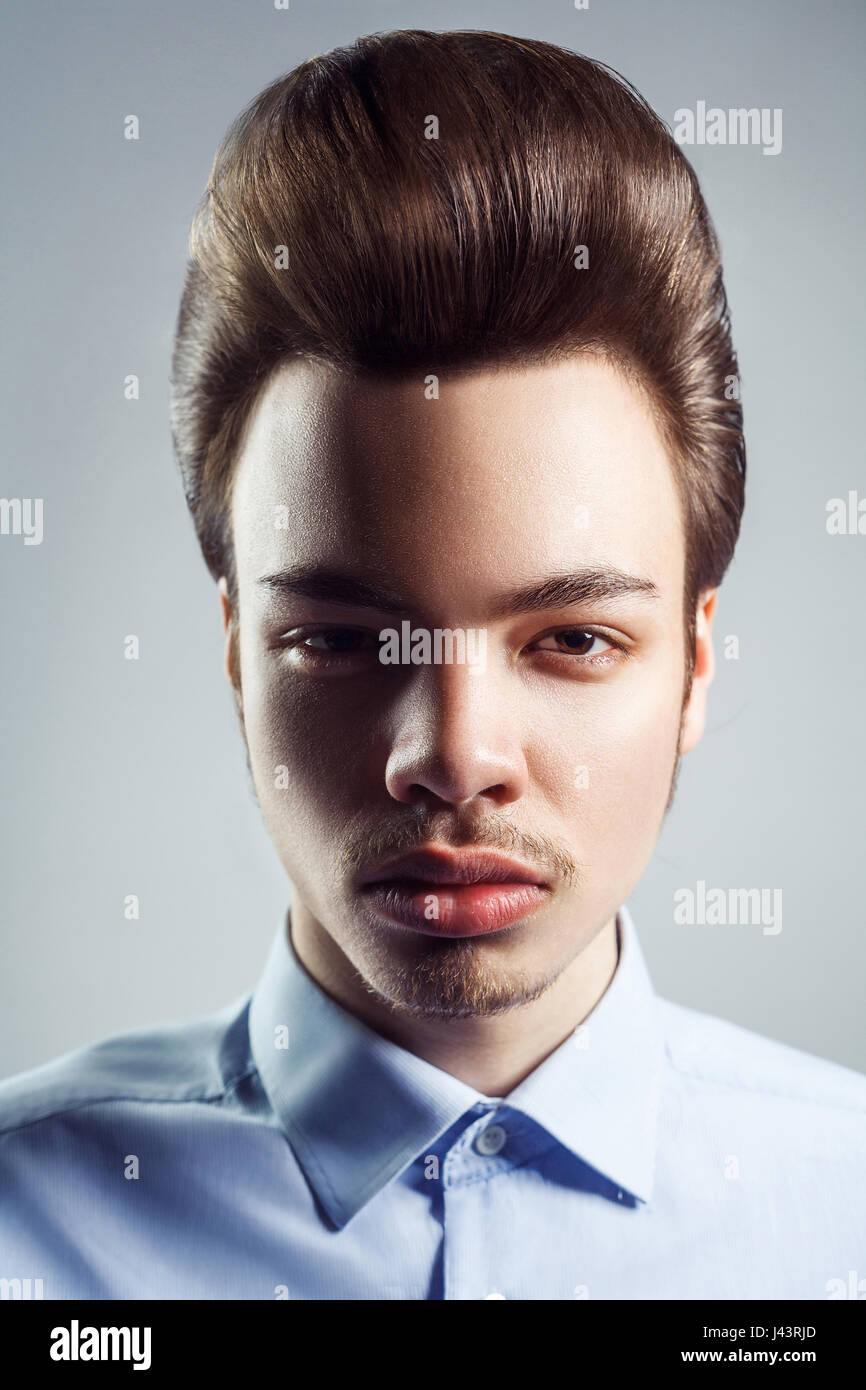 Portrait Of Young Man With Retro Classic Pompadour Hairstyle Studio