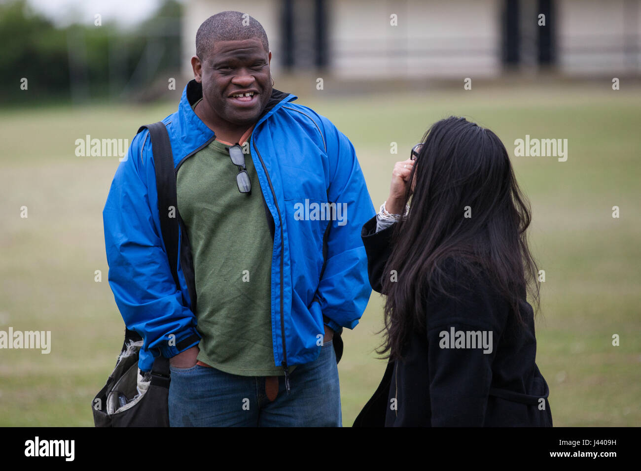London, UK. 9th May, 2017. Gary Younge, journalist, author and broadcaster, works on a story in South Harrow during - Stock Image