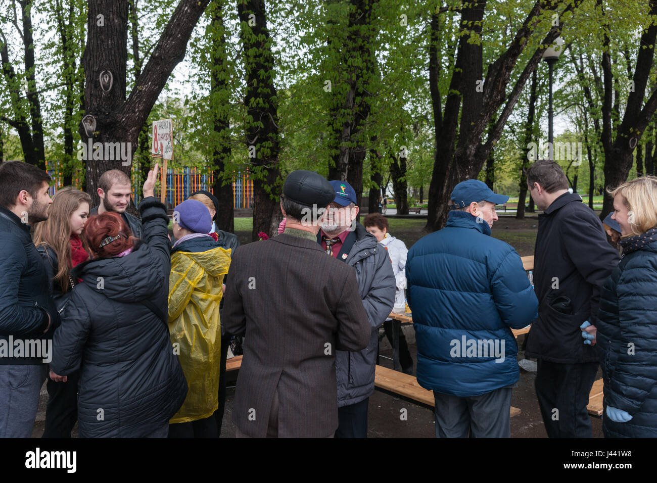 Russia, Moscow, Tuesday, May 9, 2017. Cold and rainy Victory Day. Still people go to Gorky park to celebrate it - Stock Image