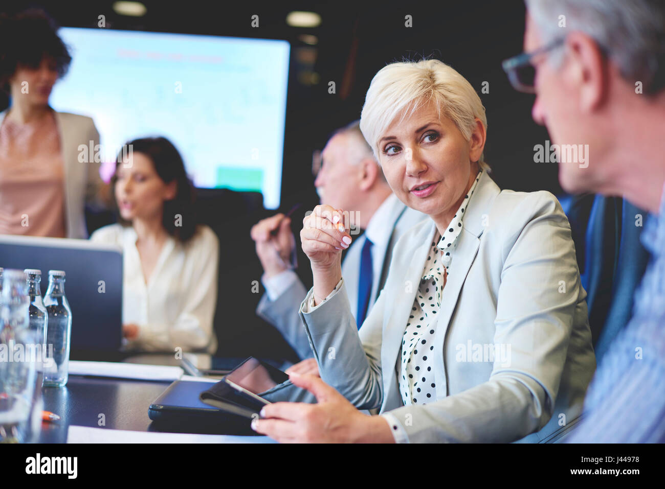 Business woman sharing concept with work mate - Stock Image