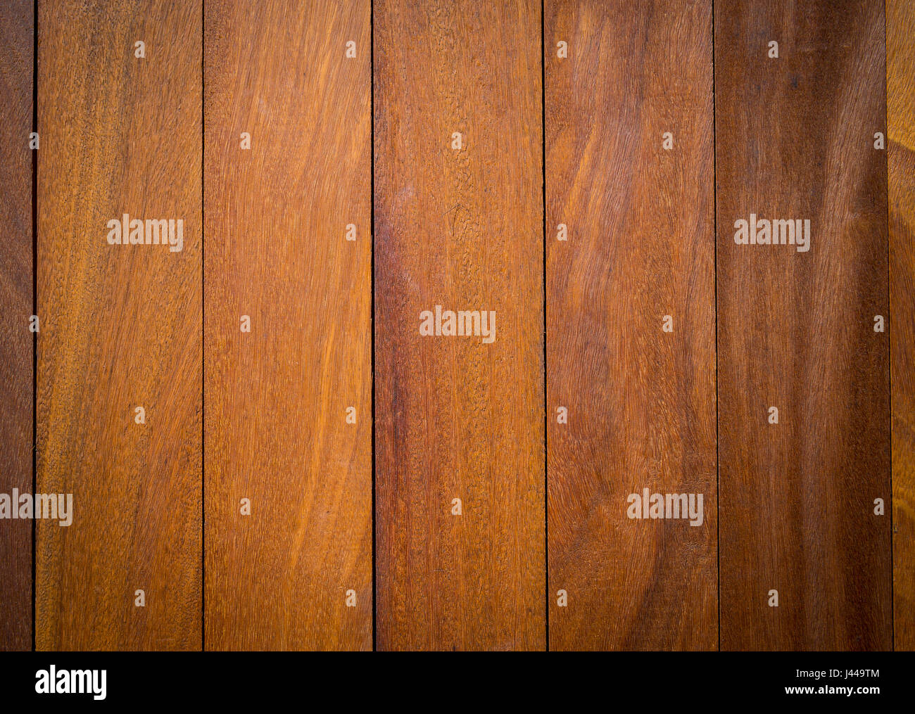 Wood panel background in smooth brown grain - Stock Image