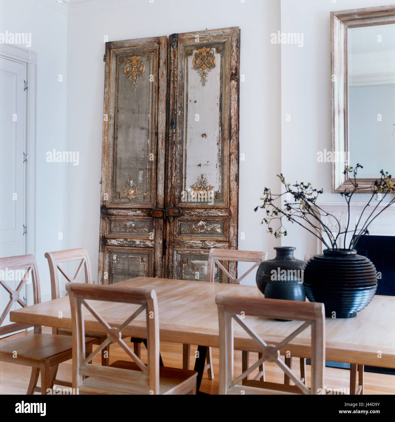 Louis XVI carved chateau doors adds depth and texture to dining room - Stock Image