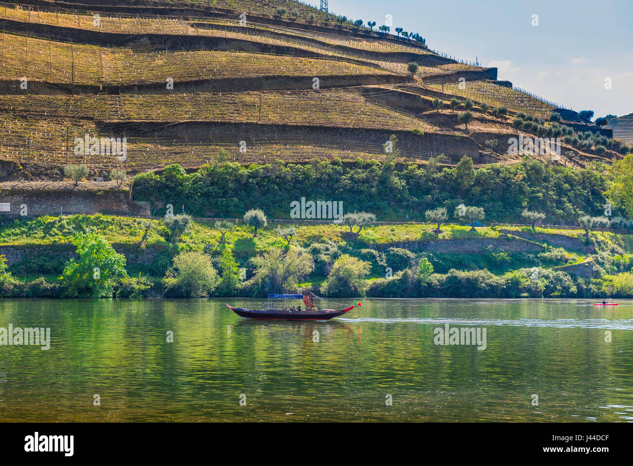 Douro River Valley, a traditional rabelo boat carrying tourists cruises up the Rio Douro near the port wine town - Stock Image