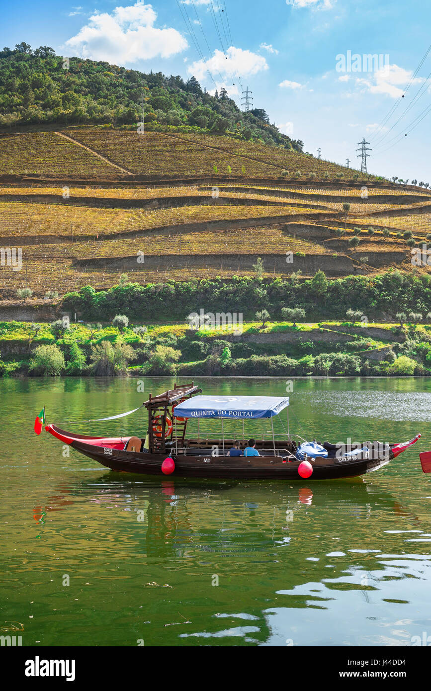 Douro River Valley, tourists in the Douro Valley near the town of Pinhao tour the Rio Douro in a traditional rabelo - Stock Image