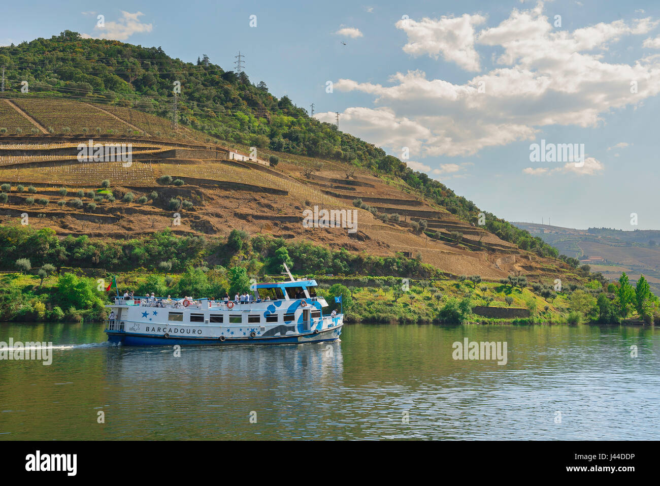 Portugal cruise Douro, a cruise ship carrying day-trippers heads down the Douro River Valley close to the port wine - Stock Image