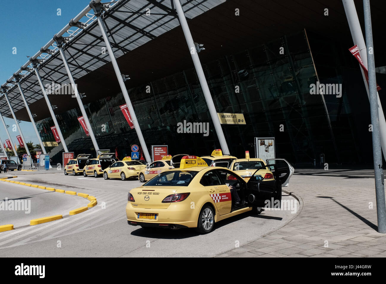 Taxis await passangers outside Tirana International Airport. Albania has a population of just over 3 million, only - Stock Image