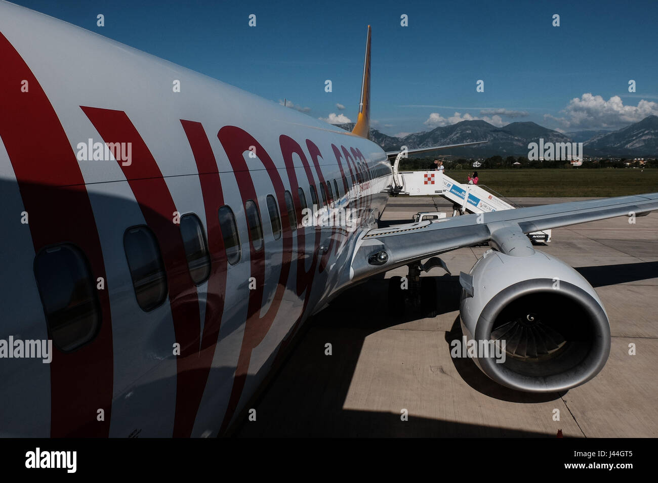 Passangers board a Turkish Pegasus airline at Tirana International Airport. Albania has a population of just over - Stock Image
