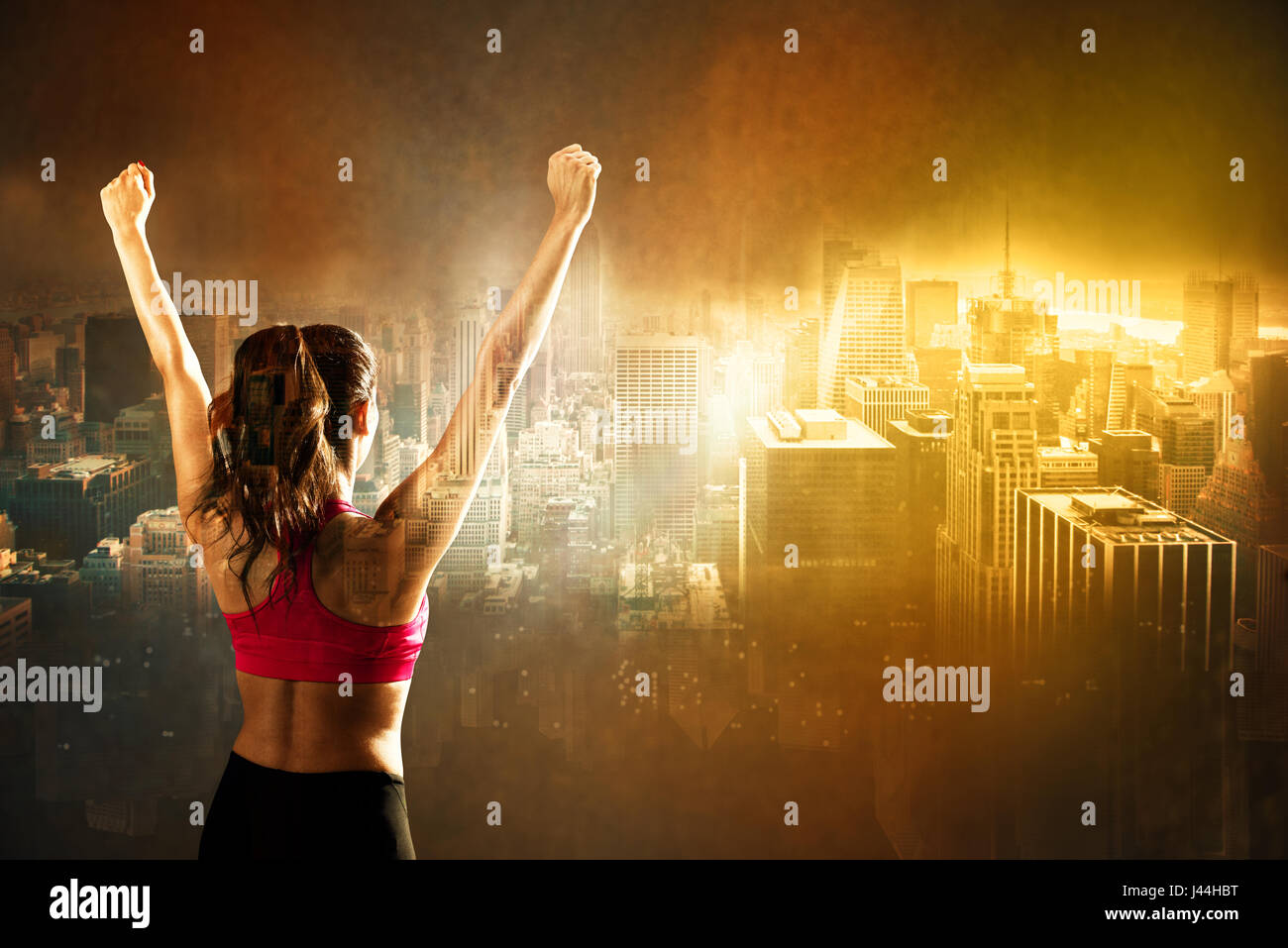 Athletic woman on city background - Stock Image