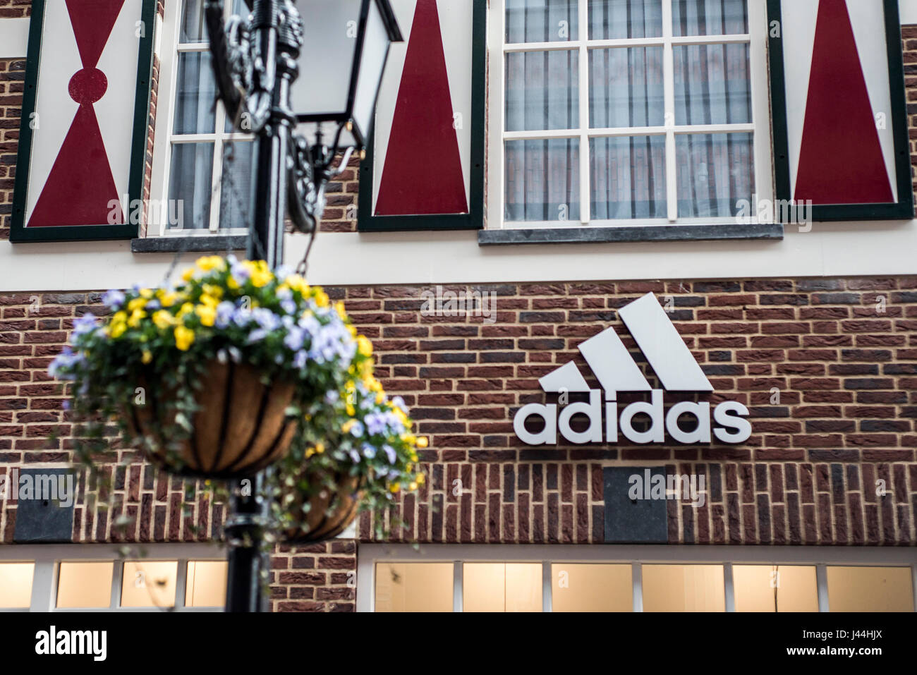 aeffcabb7534 Roermond Netherlands 07.05.2017 - Logo of the adidas brick house Store in  the Mc Arthur Glen Designer Outlet shopping area