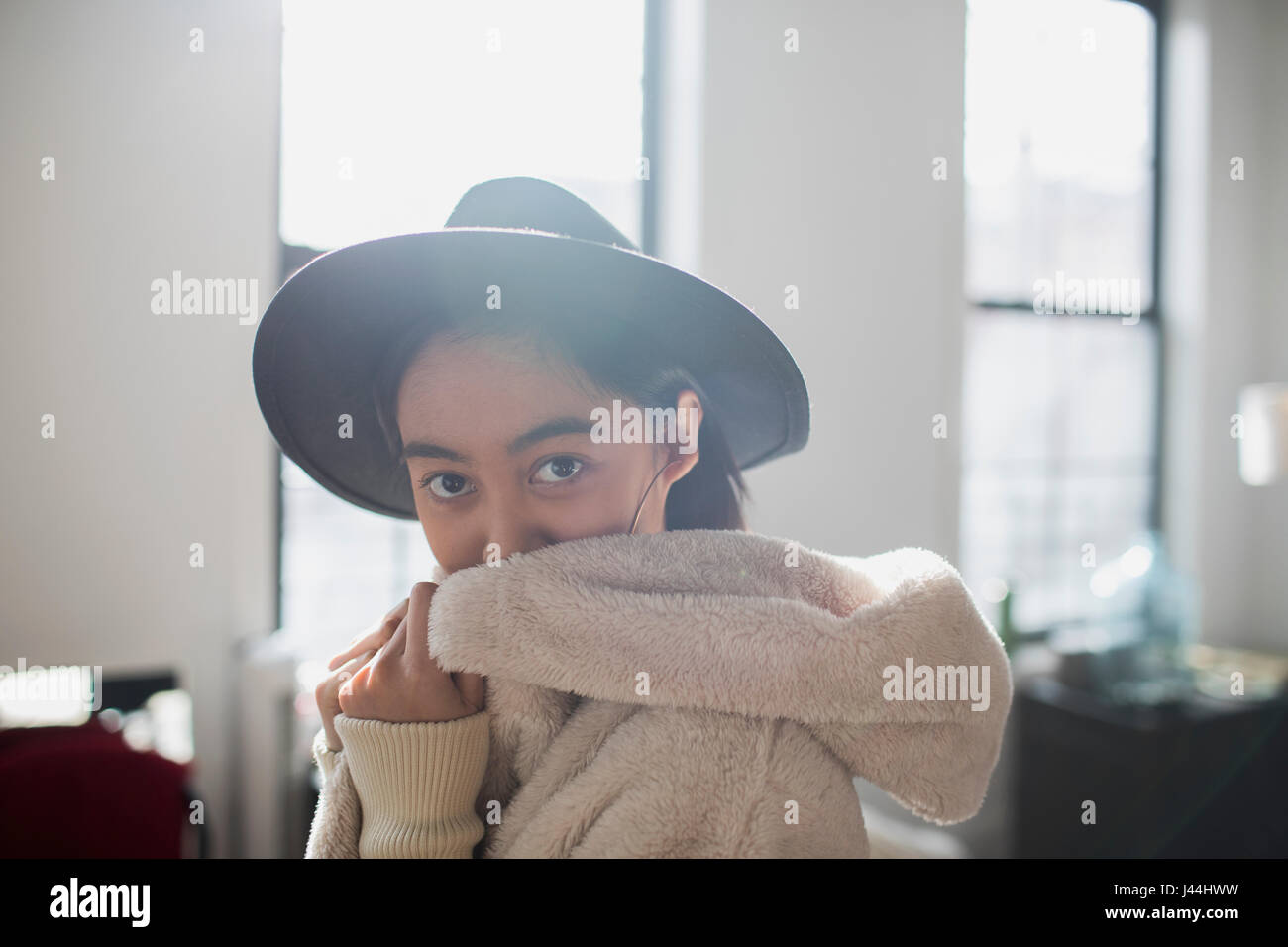 A young woman wearing a hat and robe - Stock Image