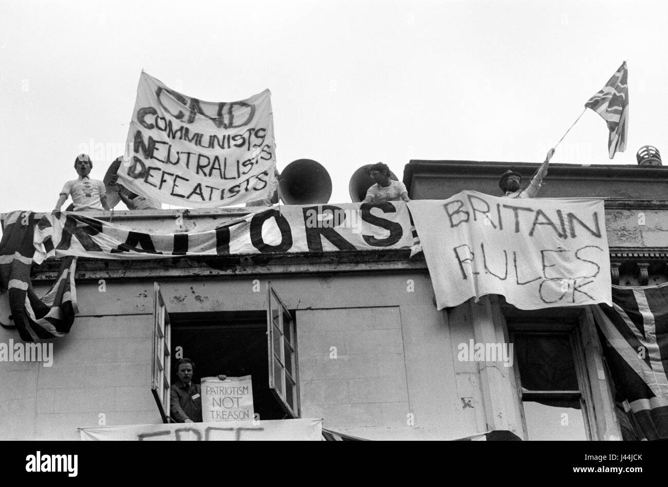 Pro Falkland war demo London May 1983 people hanging banners from building in Whitehall London CND Communists Neutralists - Stock Image