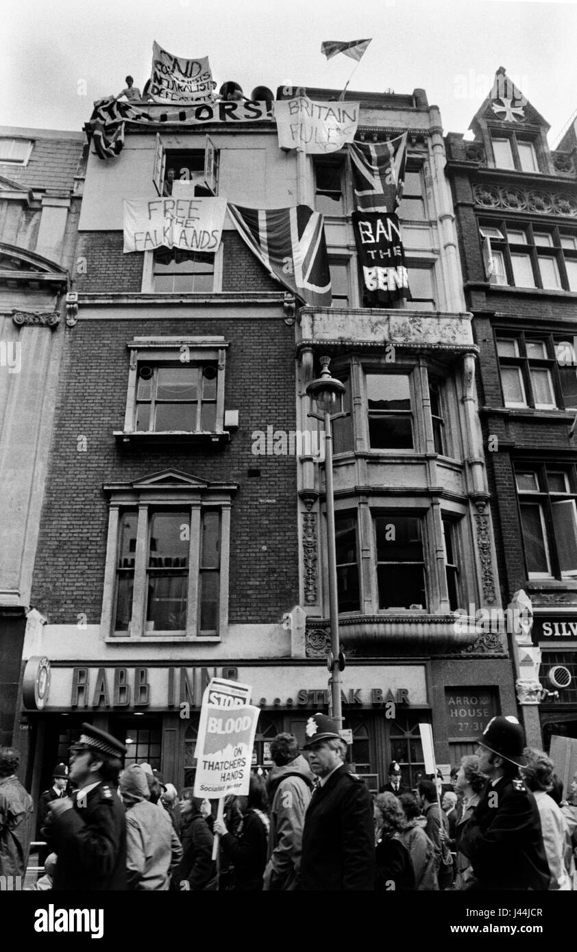 Anti Falkland war demo Whitehall London May 1983 with counter demonstration, people hanging banners from building - Stock Image