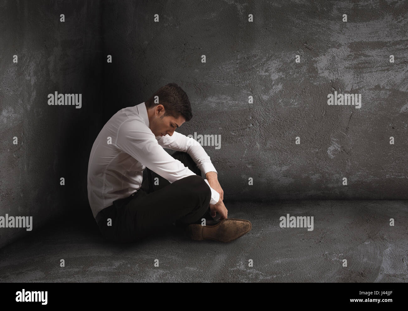 Alone desperate businessman. solitude and failure concept - Stock Image