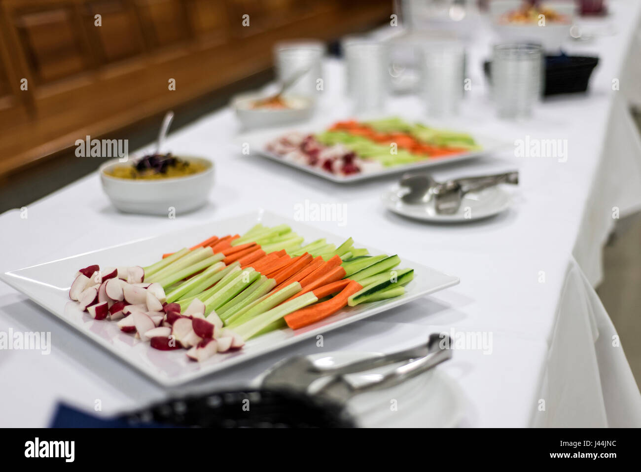Veggie salad mix, celery and carrot sticks on white table healty dinner - Stock Image