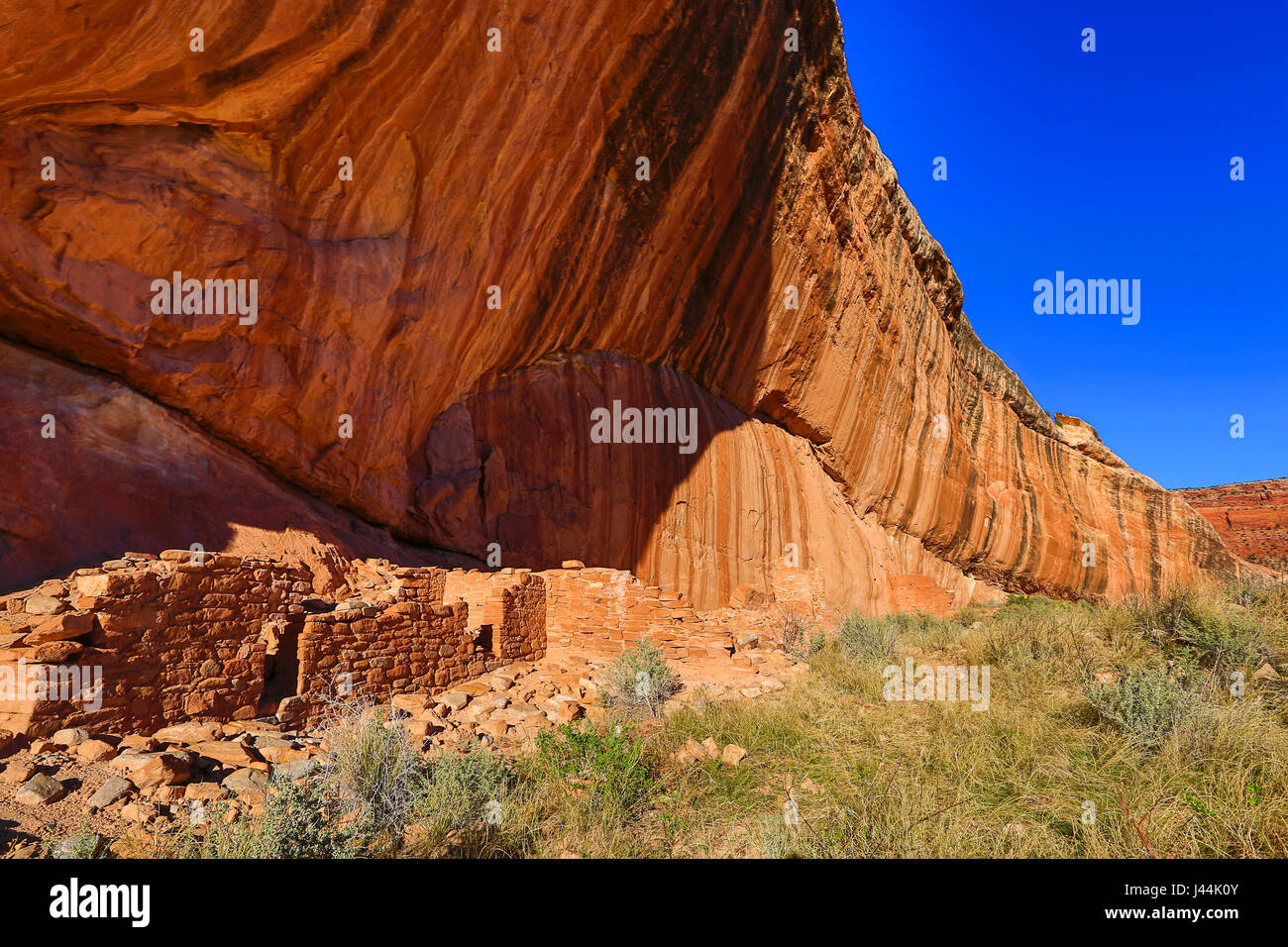 A  rock wall at the Arch Canyon Ruin, an Ancestral Puebloan ruin in an alcove at the bottom of Arch Canyon in the - Stock Image