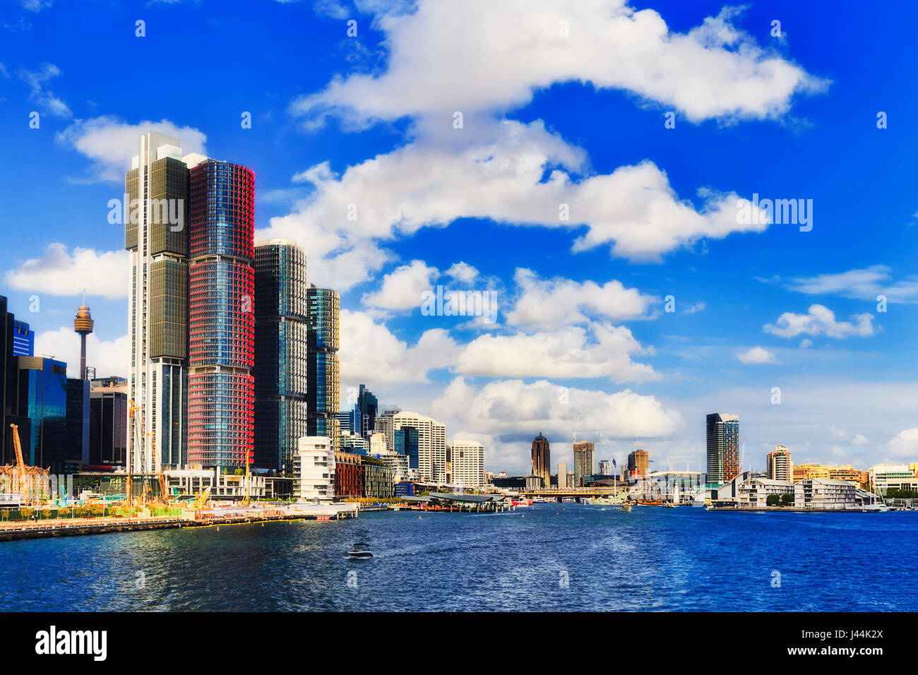 Sydney city Darling Harbour from new tall towers of Barangaroo to Pyrmont from mid Sydney harbour on a sunny day. - Stock Image