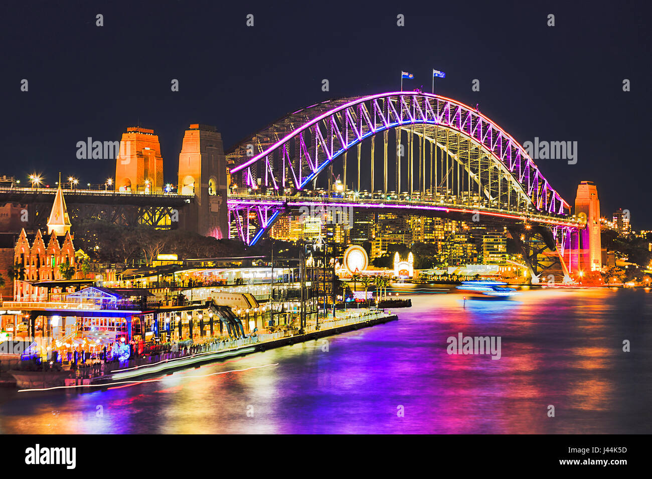 Huge arch of Sydney Harbour Bridge brightly illuminated during annual light show Sydney vivid sydney festival. Overseas - Stock Image