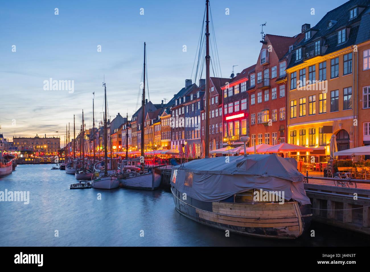 Nyhavn Canal at night in Copenhagen city, Denmark. - Stock Image