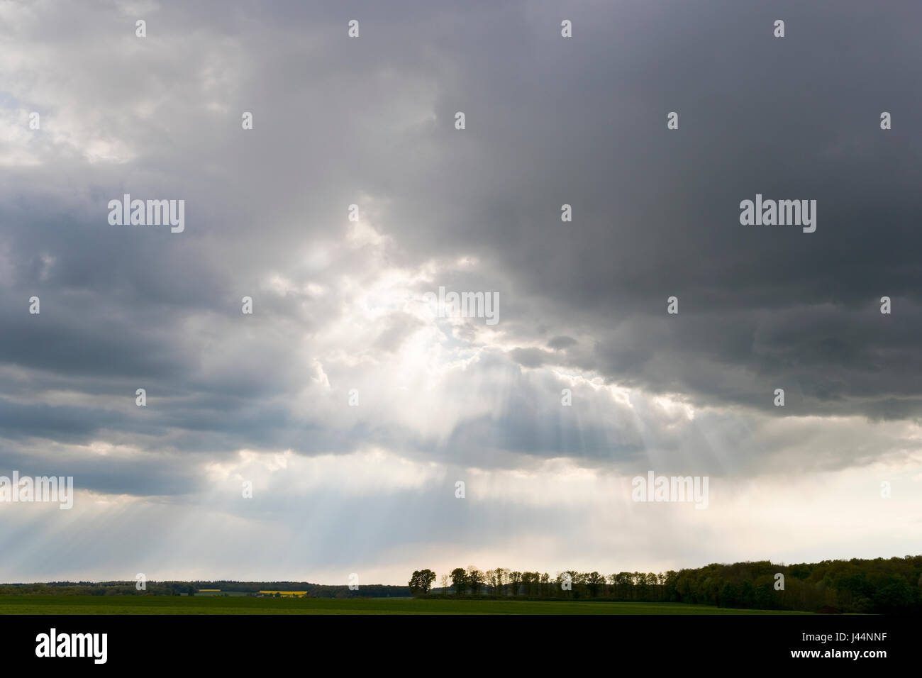 Sun rays between clouds during a Storm in Loiret, France - Stock Image
