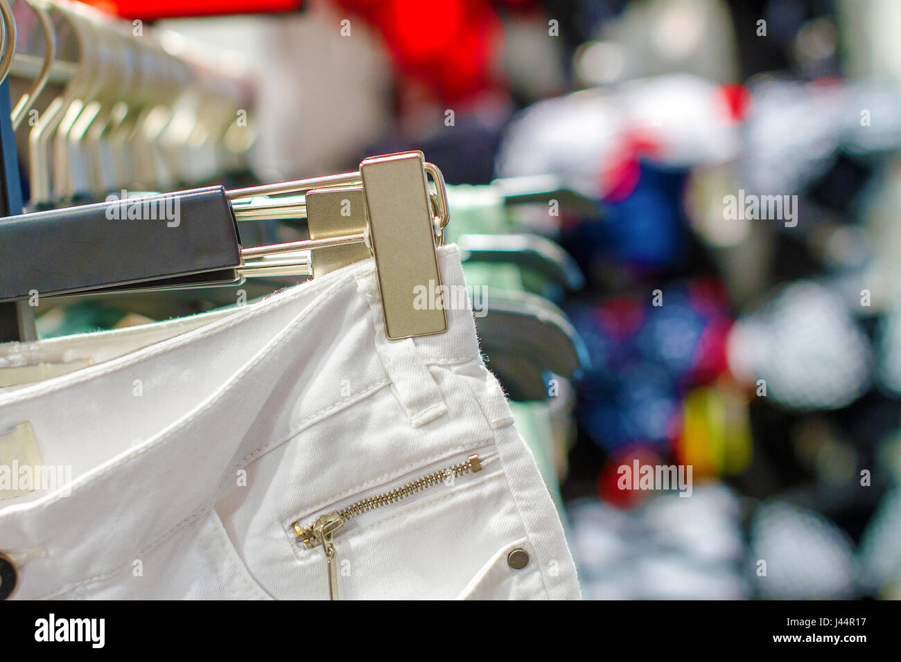 a Preview ladies skirts hanging on display - Stock Image
