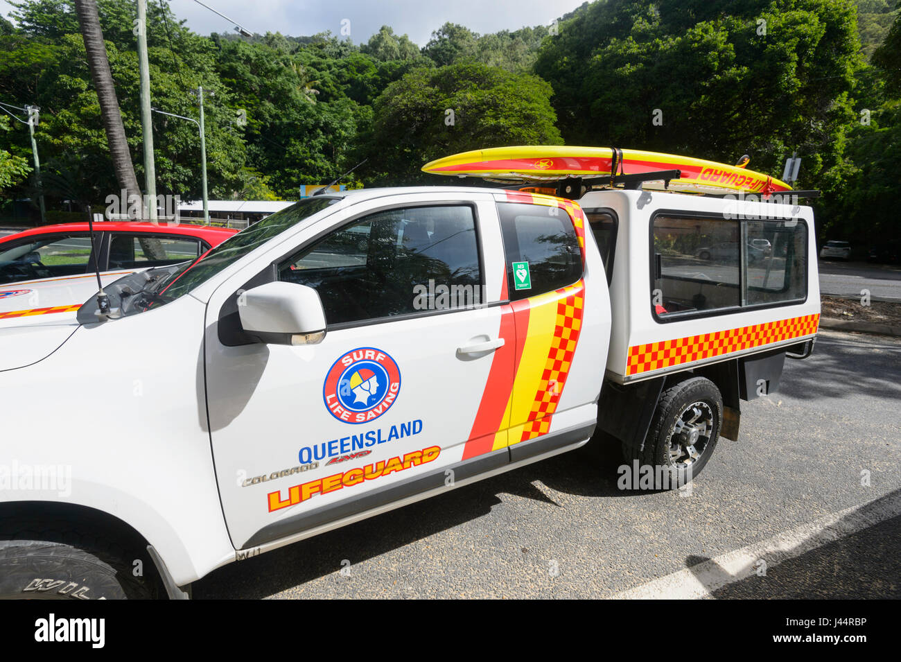 Queensland Lifeguard's truck with surfboard on roof parked at Ellis Beach, Far North Queensland, FNQ, Australia - Stock Image