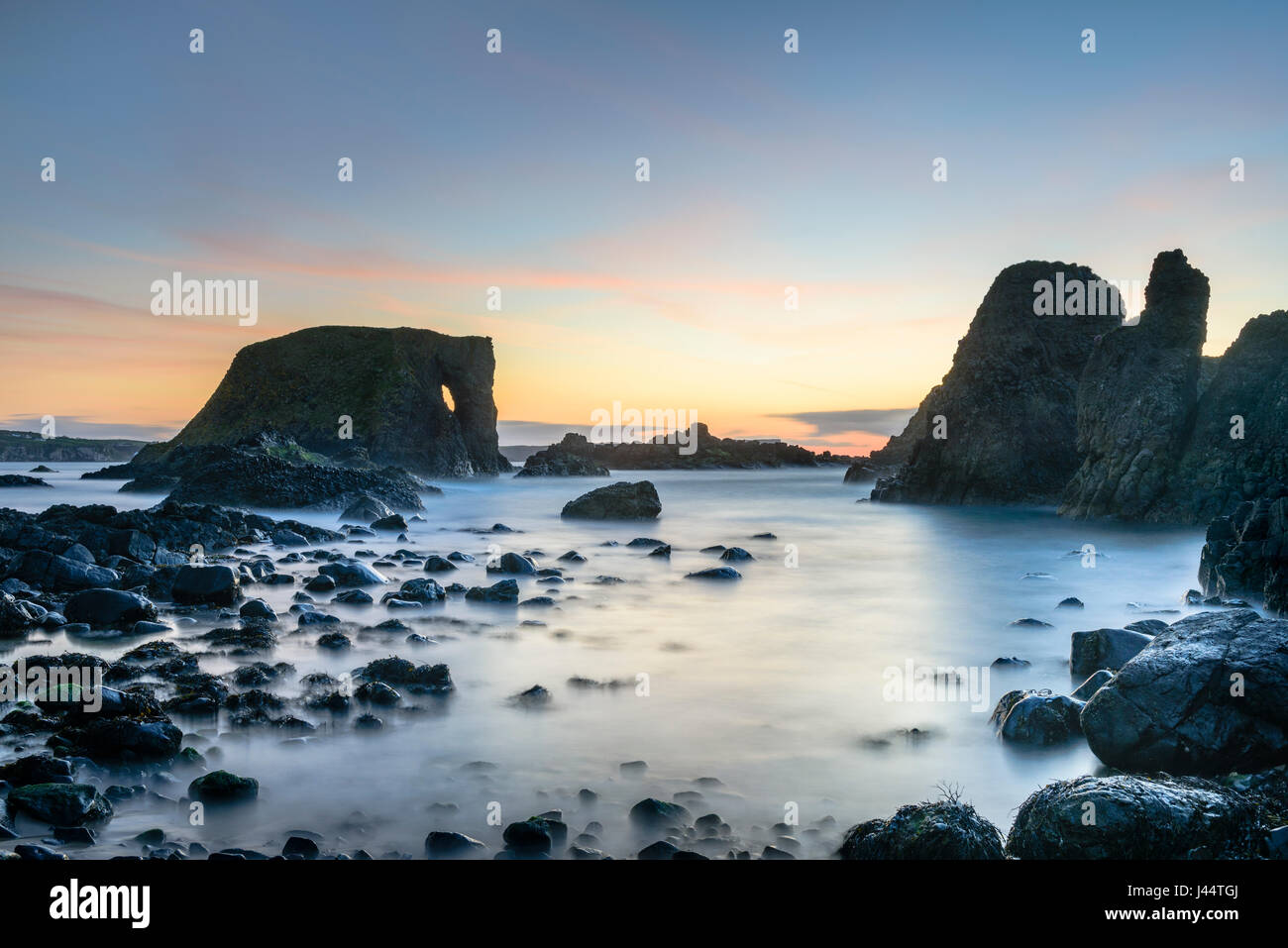 Sunset at Elephant Rock at Carricknaford a coastal scene of rocky shore near Ballintoy and Whitepark Bay on the Antrim coast of Northern Ireland Stock Photo
