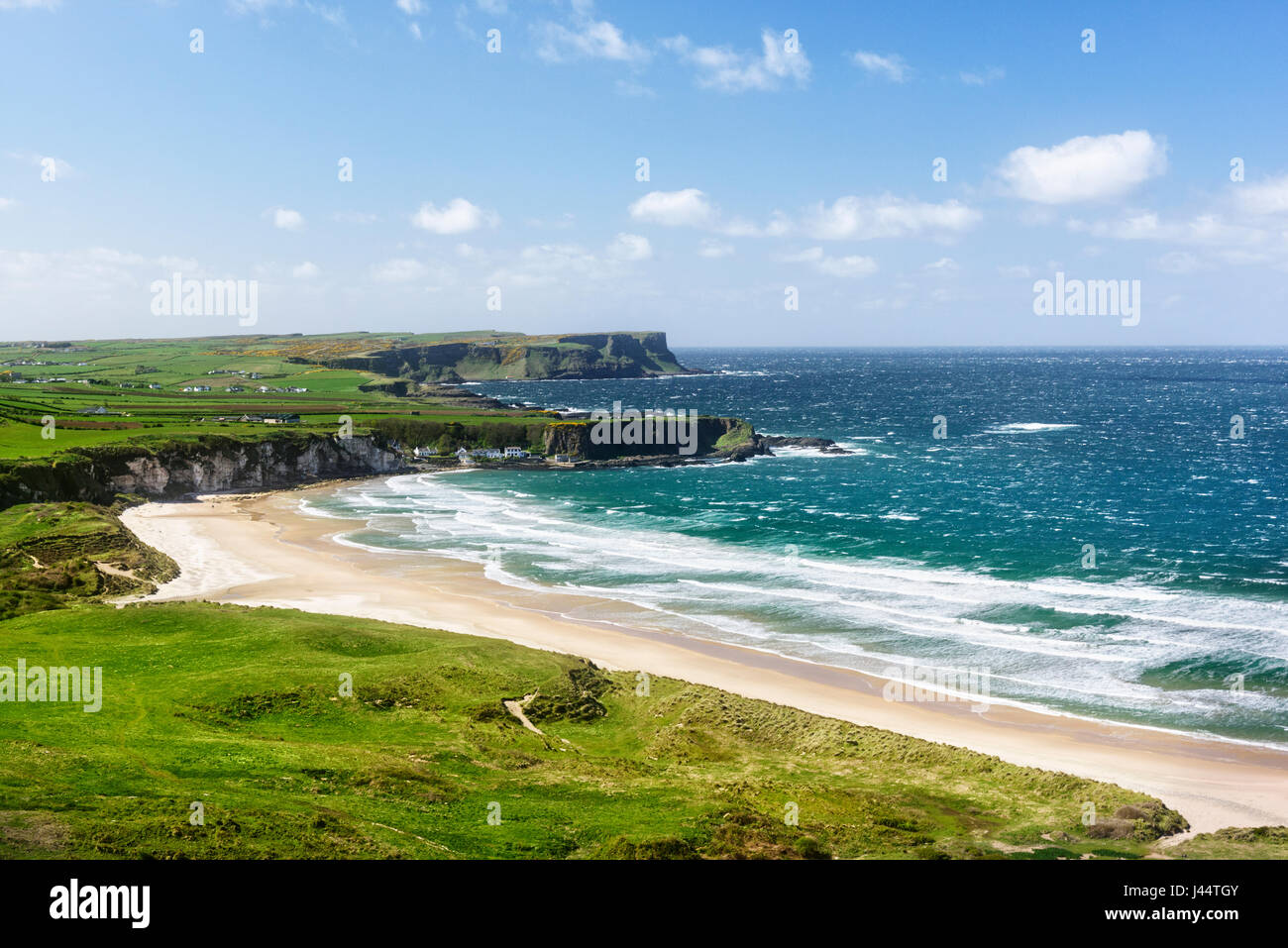 The expansive beach at Whitepark Bay located between Portrush and Ballycastle on the Causeway Coast of North Antrim Stock Photo