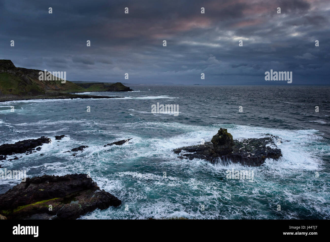 Dramatic coastline at Giant's Causeway on the Causeway Coast bear Bushmills in Moyle Country Antrim in Northern Stock Photo
