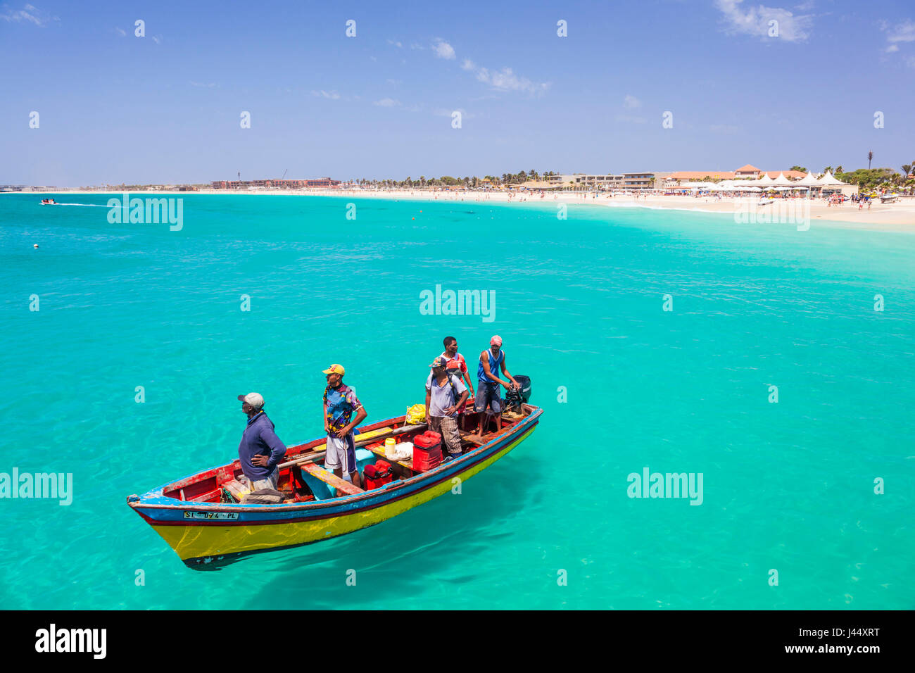 CAPE VERDE SAL Fishermen bringing their catch of fish in fishing boats to the pier at Santa Maria, Sal island , - Stock Image