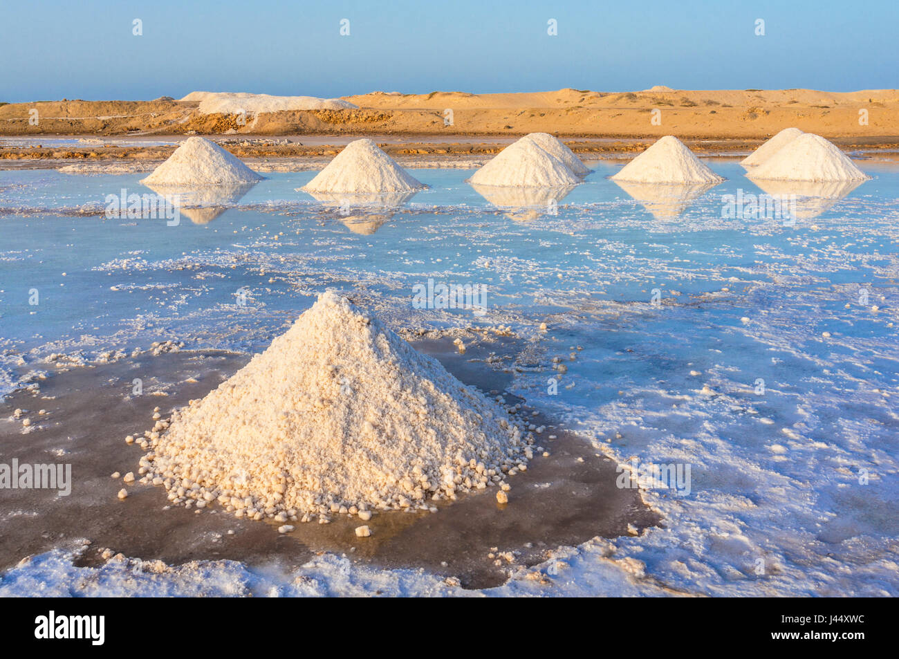CAPE VERDE SAL Piles of salt collected from natural salt pans at Salinas, just outside Santa Maria, Sal island, - Stock Image