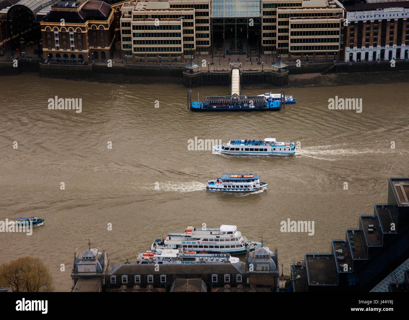 two tourist pleasure cruisers passing on Thames London from above - Stock Image
