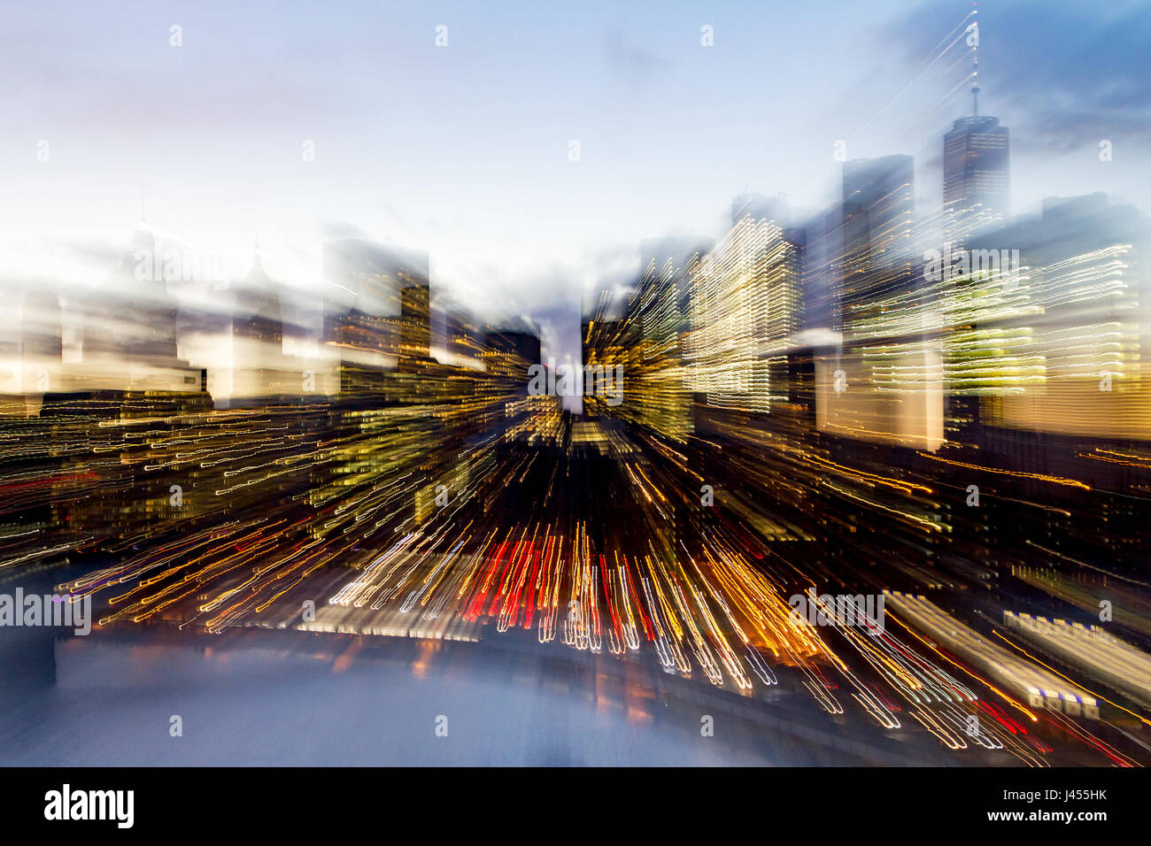 Abstract Blurred Skyline Of New York City Downtown Building Lights At Dusk  In Manhattan
