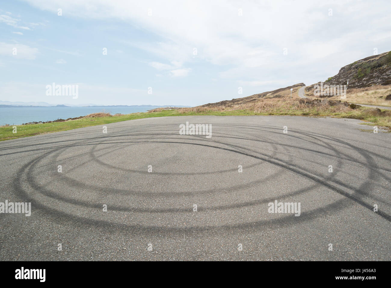 donut car tyre skid marks at viewpoint, Applecross peninsula, Wester Ross, Scottish Highlands, UK - Stock Image