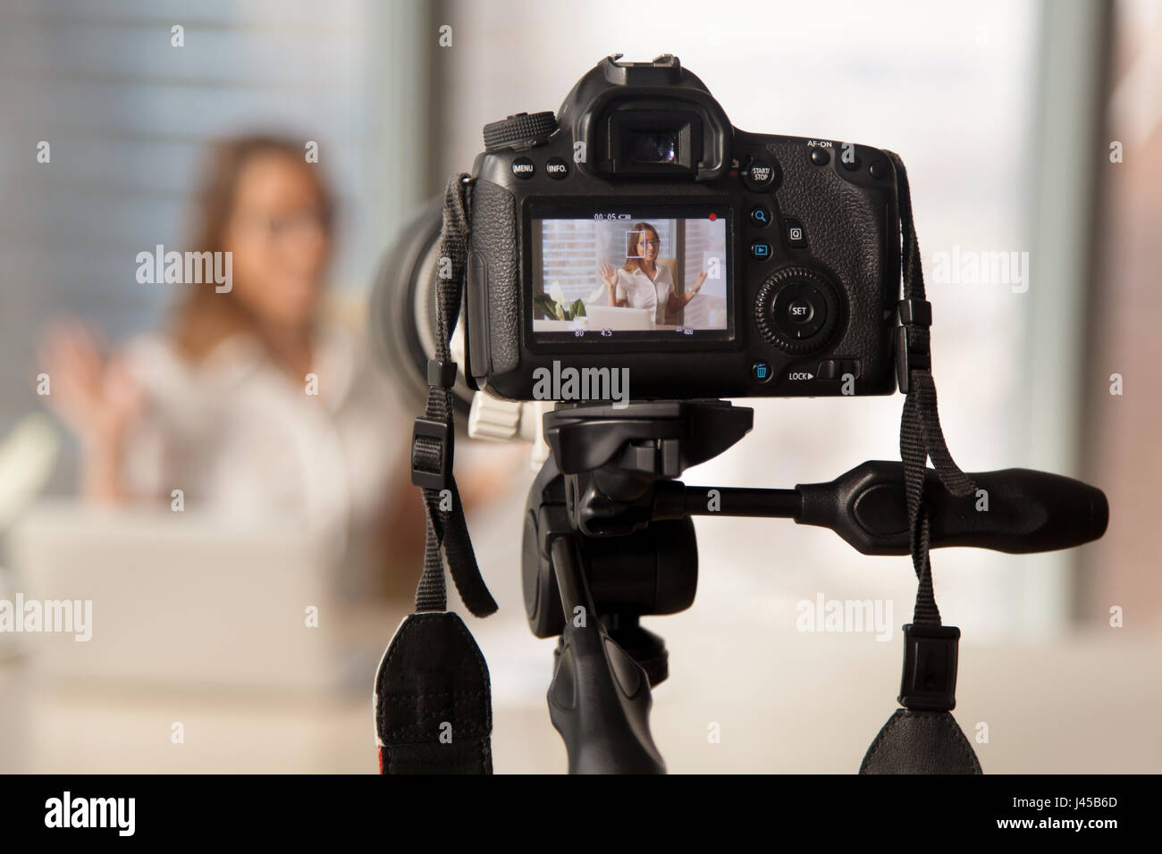 Recording business video on modern DSLR camera - Stock Image