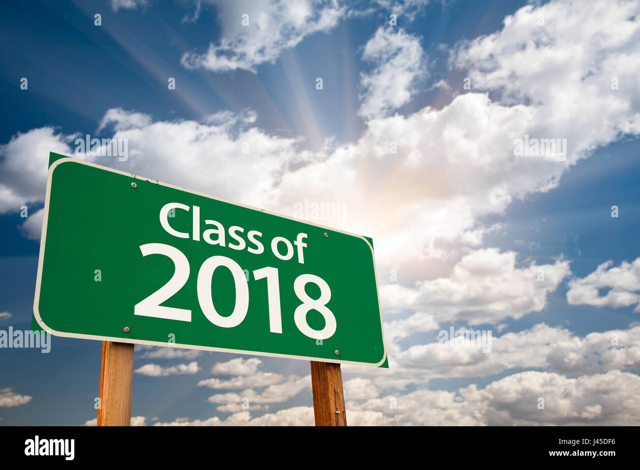 Class of 2018 Green Road Sign with Dramatic Clouds and Sky. Stock Photo
