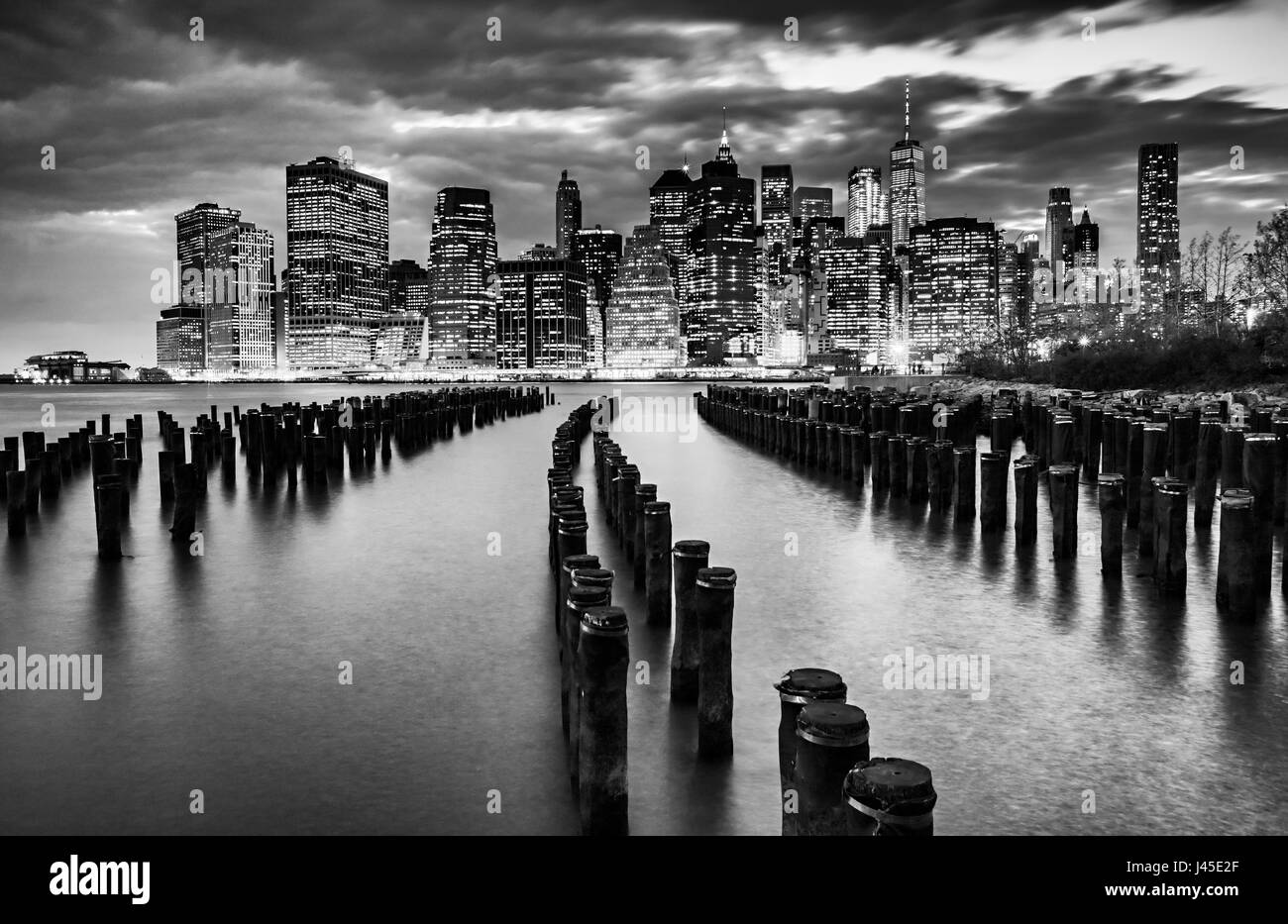 New York City skyline with wood pilings, black & white Stock