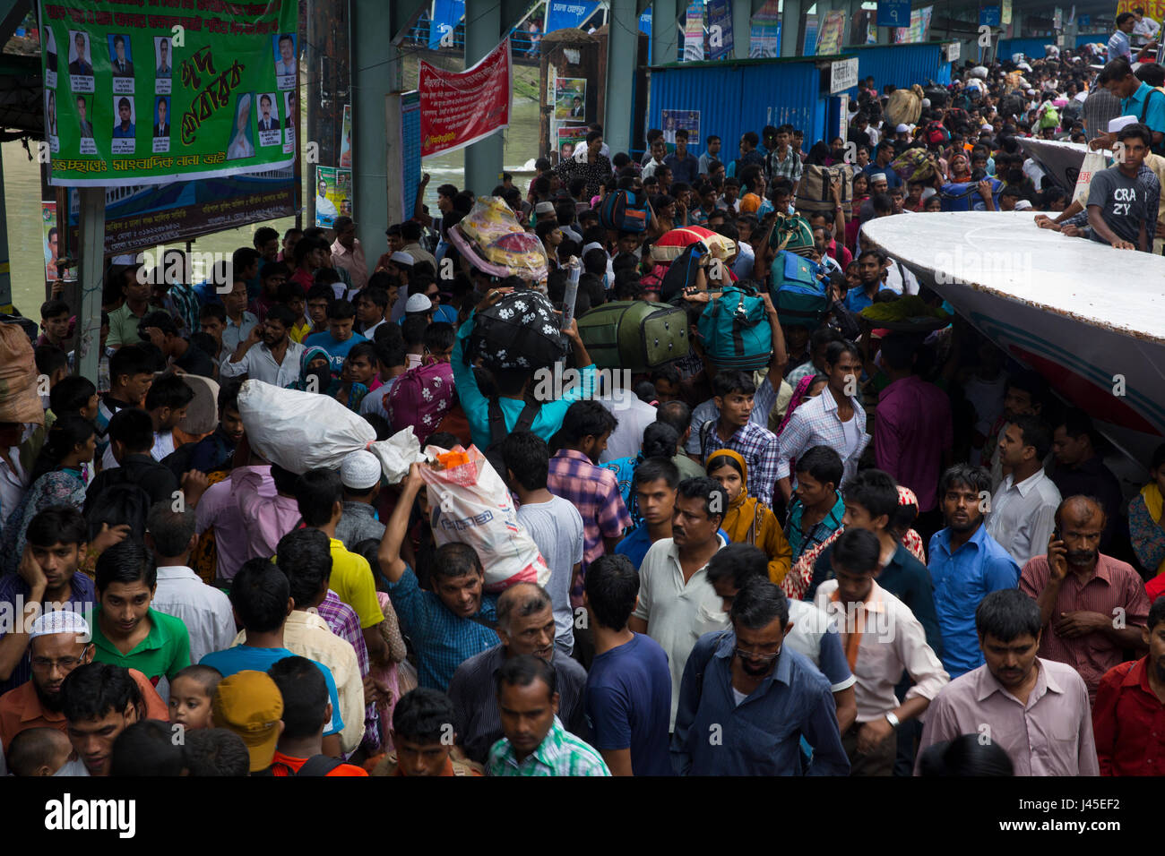 Homebound people flock at Sadarghat Launch Terminal to leave the capital for spending Eid-ul-Fitr holidays in their - Stock Image