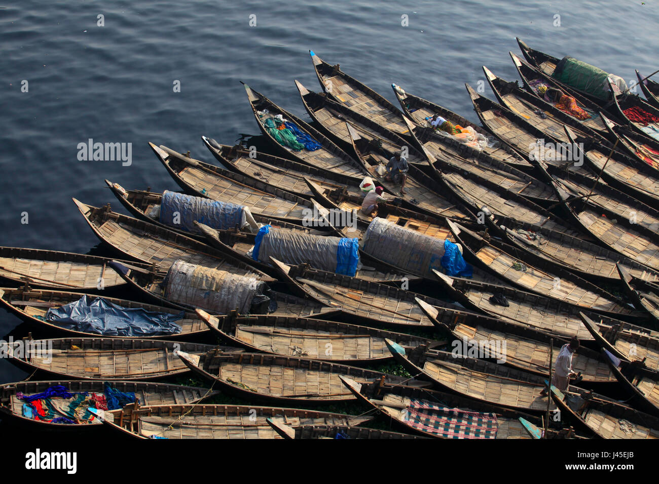 Boats are harboured on the Buriganga River at Sadarghat. Dhaka, Bangladesh. - Stock Image