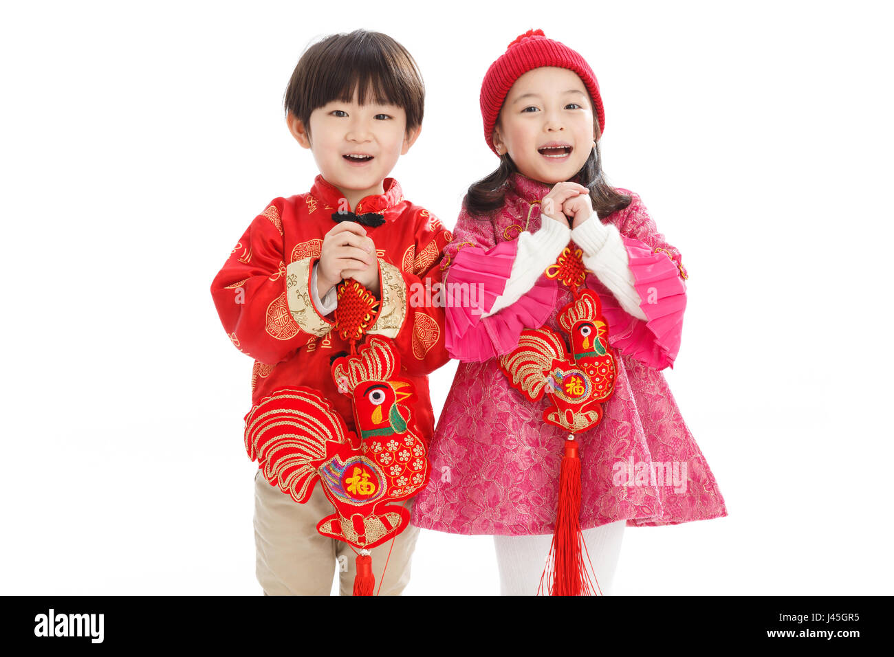 Two children celebrate the new year - Stock Image