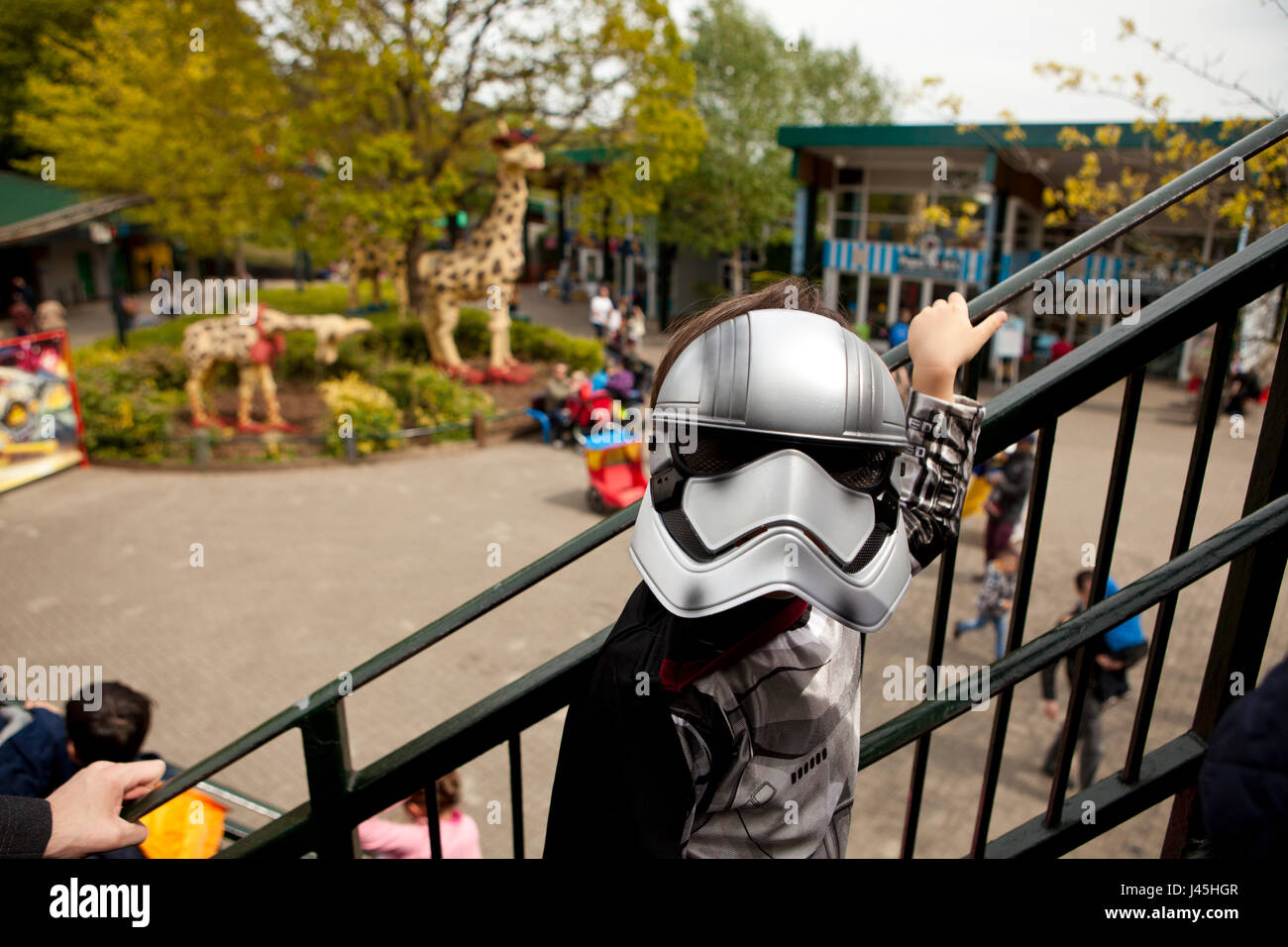 National Star Wars day parade at Legoland UK Berkshire a boy dressed as captain Phasma waiting in a queue to get Stock Photo