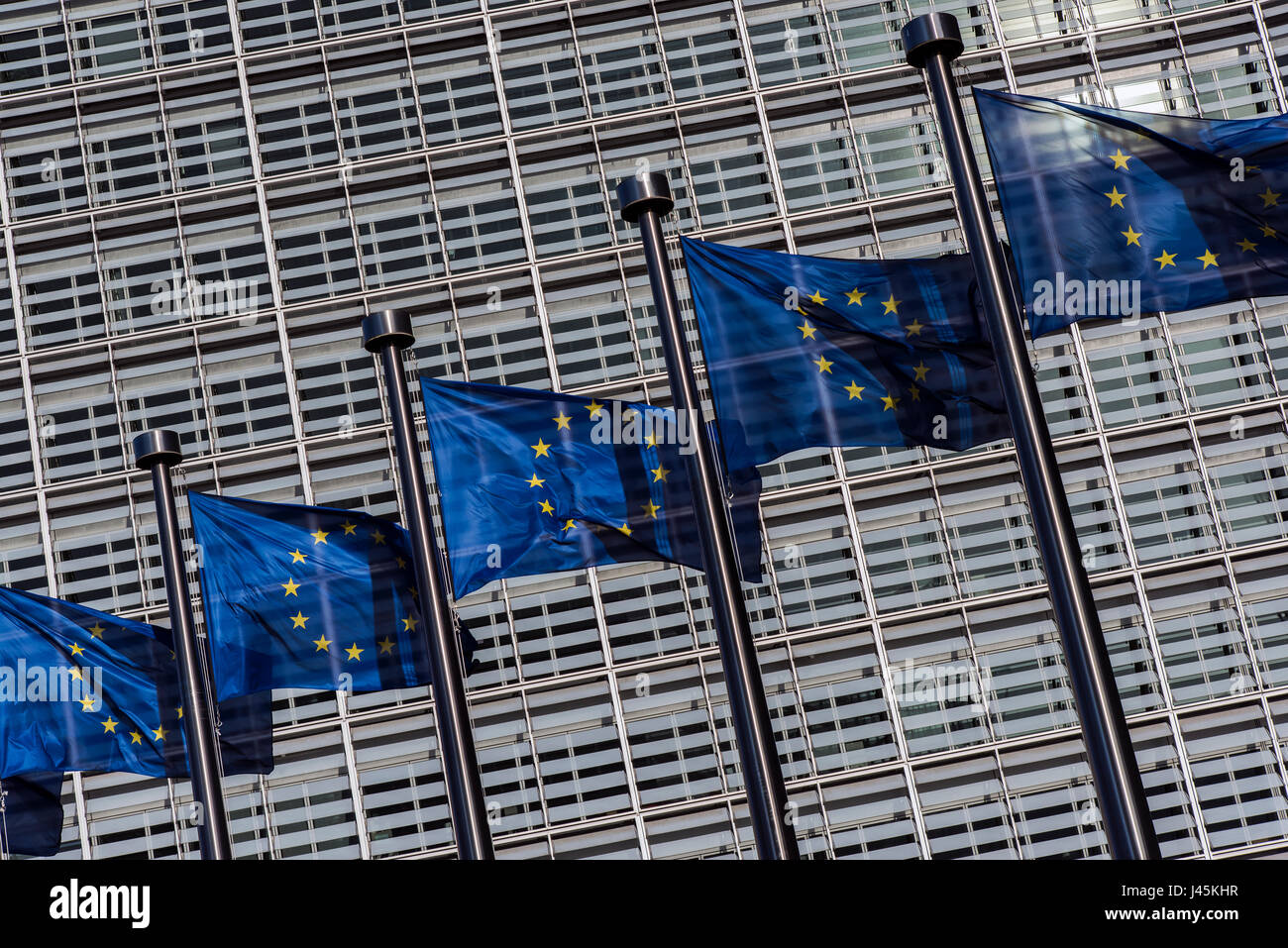 Flags of European Union weaving outside the European Commission building, Brussels, Belgium - Stock Image