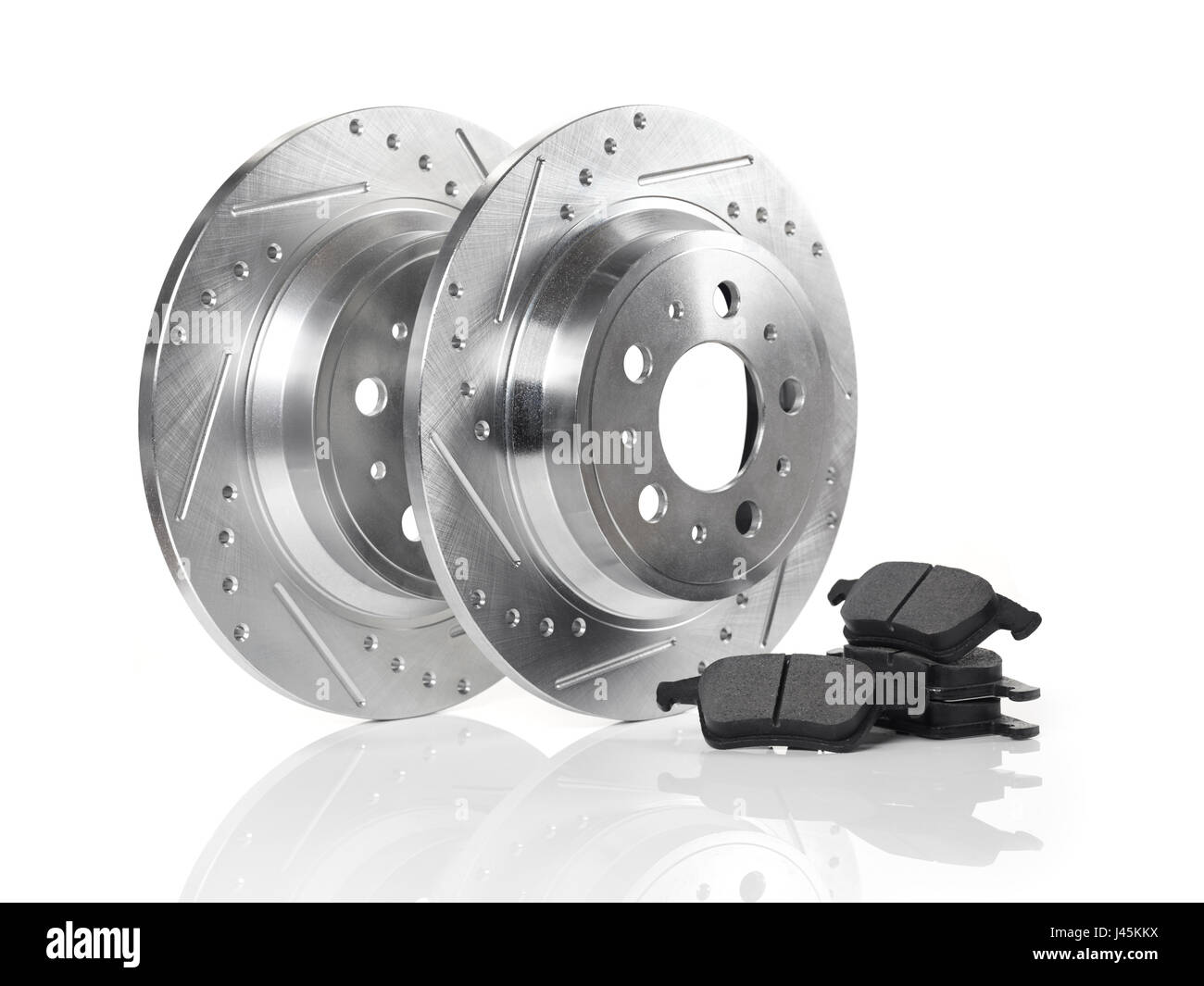 Car brake discs, rotors and break pads isolated on white background. Automotive parts still life. - Stock Image