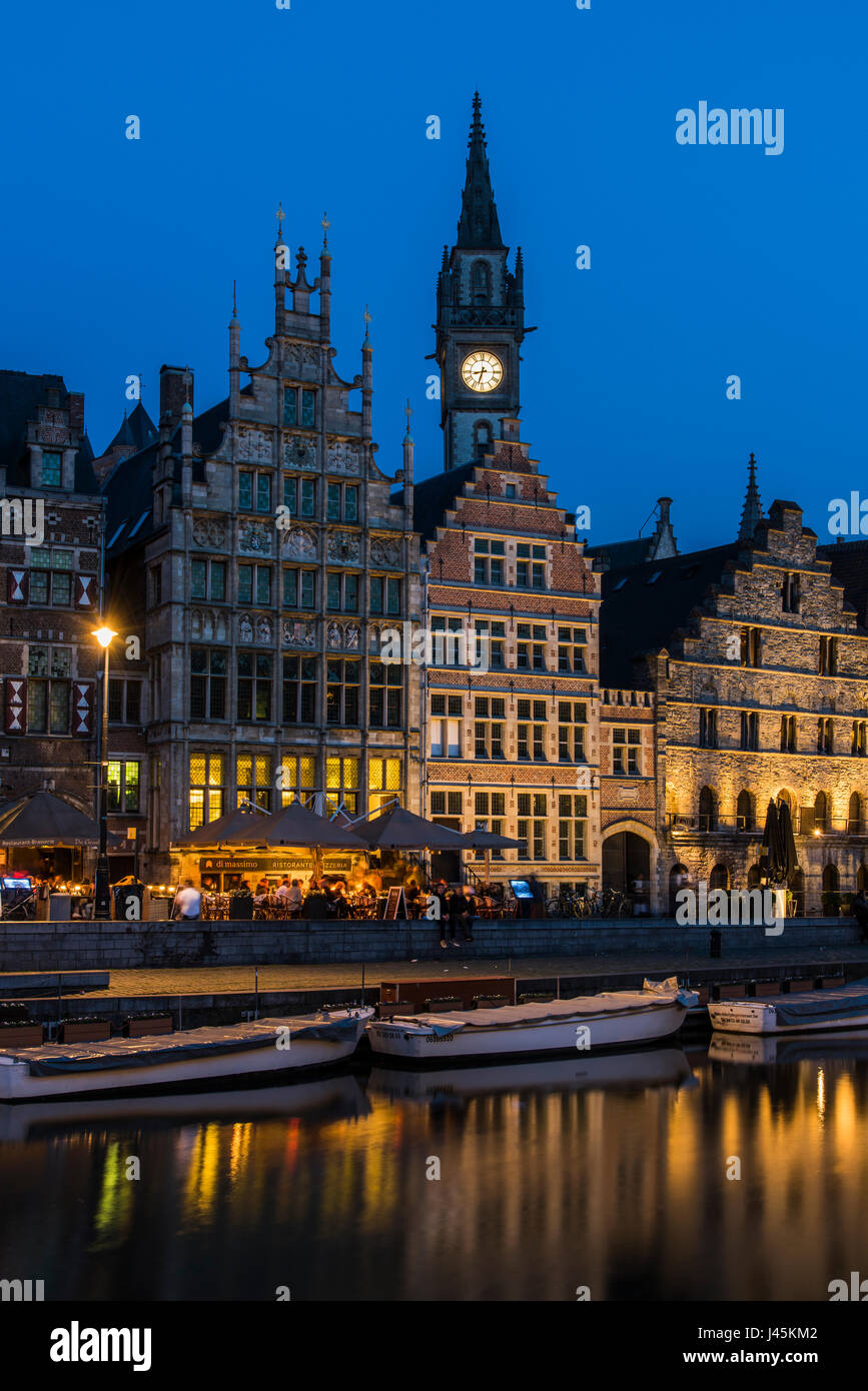 Night view of Graslei quay with Post Plaza tower, Ghent, East Flanders, Belgium - Stock Image